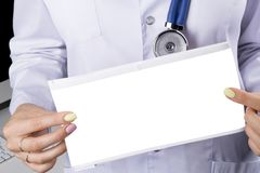 Blank empty Electrocardiogram screen in hand of a female doctor. Medical health care. Clinic cardiology heart rhythm and pulse tes. T closeup. Cardiogram royalty free stock image