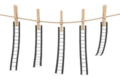 Blank and Empty Films Hanging on Rope by Wooden Clothespins. 3d. Blank and Empty Films Hanging on Rope by Wooden Clothespins on a white background. 3d Rendering Royalty Free Stock Images