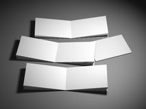 Blank empty magazine or book template lying on a gray background. 3d rendering Stock Image