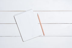 Blank empty notepad with pencil on table Royalty Free Stock Image