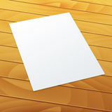 Blank/empty A4 office paper on a wood background. Realistic Blank/empty A4 office paper in perspective on a wood background - Vector MockUp Royalty Free Stock Images