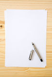 Blank or empty paper with pen Stock Photography