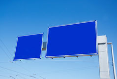 Blank empty road blue signs. With sky in the background royalty free stock images