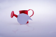 Blank empty speech bubble  and  watering can Royalty Free Stock Photos