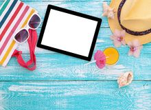 Blank empty tablet computer, summer accessories on Royalty Free Stock Image