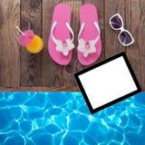 Blank empty tablet computer, summer accessories on. Blank empty tablet computer on beach. Trendy summer accessories on wooden background pool. Sunglasses, orange Stock Photo