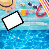 Blank empty tablet computer, summer accessories on Stock Image