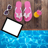 Blank empty tablet computer, summer accessories on Stock Photography