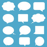 Blank empty white speech bubbles on blue backgroun Royalty Free Stock Photography