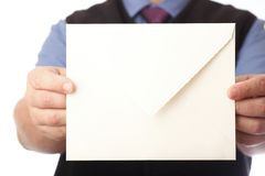 Blank envelop in a hand Stock Photo