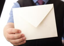 Blank envelop in a hand. Businessman showing envelop. You can just add your text there Stock Photography