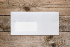 Blank envelope with address window on table Royalty Free Stock Photos