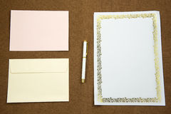 Blank envelope and paper waiting for idea with pen Stock Images