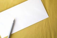 Blank envelope on yellow Stock Photos
