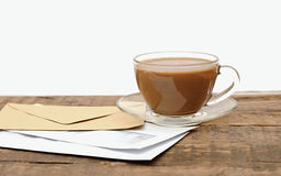 Blank envelopes and a glass coffee cup Royalty Free Stock Images