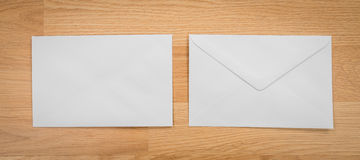 Blank envelopes on a wooden dark Stock Images