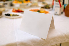 Blank event Guest Card on a banquet restaurant table Royalty Free Stock Photo