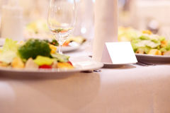 Blank event Guest Card on restaurant table Royalty Free Stock Images
