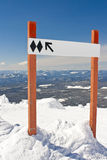 Blank Expert Terrain Ski Hill Sign. An image of a double black diamond sign high on a downhill ski and snowboard resort.  Double black diamond normally signifies Stock Photography