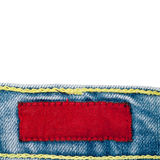 Blank fabric jeans label. Blank red fabric jeans label sewed on a blue jeans Royalty Free Stock Image
