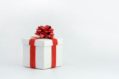 Blank fancy box. Blank white fancy box over white background with red bow Royalty Free Stock Photos