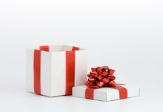 Blank fancy box. Over white background with red bow Stock Images
