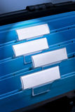 Blank Files In Filing Cabinet. A series of files with a blank tabs for designers to write on Stock Photography