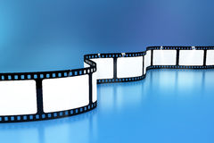 Blank film background. Blank film strips on blue background Stock Images