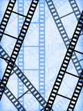 Blank film strip. On a blue background Royalty Free Stock Images