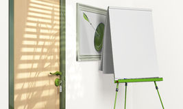 Blank flipchart inside a meeting room. With copy space - green tone Royalty Free Stock Photography