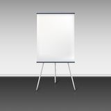 Blank flipchart stands near the wall Stock Photography