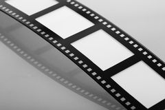 Blank Flowing Film Strip. With reflection Royalty Free Stock Image
