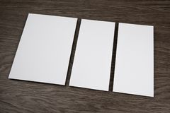 Blank flyer over wooden background to replace your design. Royalty Free Stock Photo