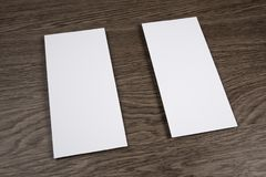 Blank flyer over wooden background to replace your design. Stock Images