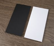 Blank flyer over wooden background to replace your design. Stock Photos