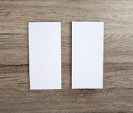 Blank flyer over wooden background to replace your design. Royalty Free Stock Images