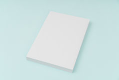 Blank flyer poster, brochure mockup,A4, US-Letter, on blue backg Royalty Free Stock Photo