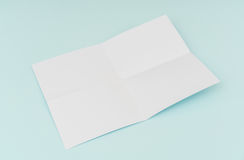 Blank flyer poster, brochure mockup,A4, US-Letter, on blue backg. Round Stock Images