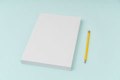 Blank flyer poster, brochure mockup,A4, US-Letter, with pencil Royalty Free Stock Image