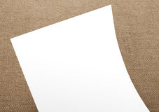 Blank flyer poster on burlap background to replace your design. Royalty Free Stock Photography