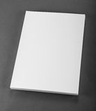 Blank flyer poster on grey to replace your design. Stock Image