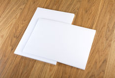 Blank flyer poster on wood to replace your design. Royalty Free Stock Images