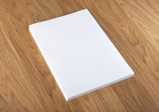 Blank flyer poster on wood to replace your design. Stock Images