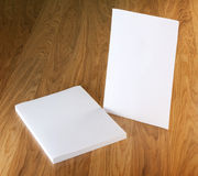 Blank flyer poster on wood to replace your design. Royalty Free Stock Photography