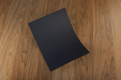 Blank flyer poster on wood to replace your design. Royalty Free Stock Photos