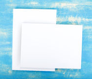 Blank flyer poster on wooden background to replace your design. Royalty Free Stock Image