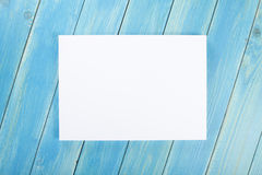 Blank flyer poster on wooden background to replace your design. Stock Photo