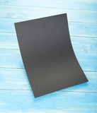 Blank flyer poster on wooden background to replace your design. Stock Photography