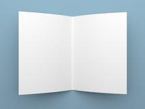 Blank folded flyer, booklet or brochure mockup. Top view of blank folded flyer, booklet or brochure mockup template on blue background Royalty Free Stock Image