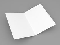 Blank folded flyer, booklet, postcard, business card or brochure. Mockup template on grey background Royalty Free Stock Photos